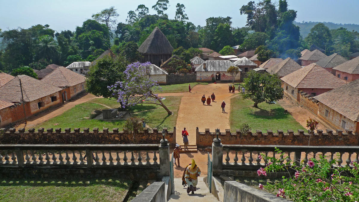 Country: Cameroon Site: Bafut Palace Caption: View of the central courtyard between the two Queens' quarters with the Fon's residence and Achum Shrine in the background Image Date: January 2011 Photographer: David Gaudzeau/World Monuments Fund Provenance: 2009 Annenberg Final Project Report Original: from digital CD CMR005